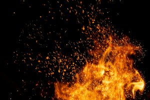 Fire,Sparks,Particles,With,Flames,Isolated,On,Black,Background.