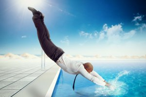 Businessman,Suit,Dives,Into,The,Swimming,Pool